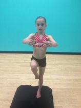 One leg stand, hands in 2nd - 8 yr old